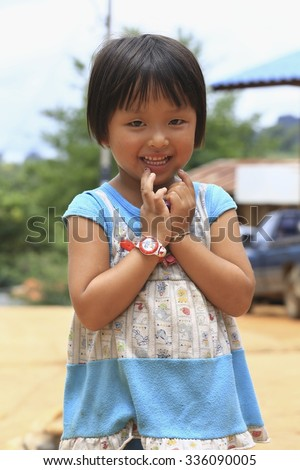 Mae Hong Son,Thailand - August 17, 2015 : little thai girl from a village in Mae Hong Son is very camera shy