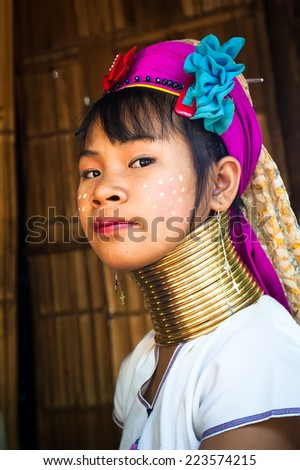 MAE HONG SON, THAILAND - DEC 4, 2013: Unidentified Karen (Kayan Lahwi Padaung) Long Neck woman with traditional brass coils and clothes in tribe village. Chang Rai province, Thailand