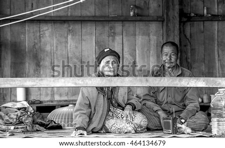 MAE HONG SON, THAILAND - DECEMBER 07 : An old Couple are sitting and relaxing at the balcony in a village near Pang ung Mae Hong Son on December 07, 2015