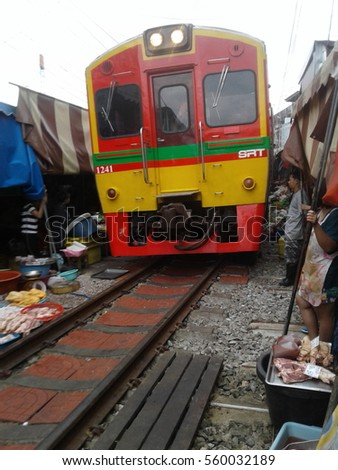 MAEKLONG, THAILAND-JAN 17: The famous railway markets at Maeklong, Thailand, 17 January, 2017, Bangkok, Thailand.Three times a day the train runs through these stalls.