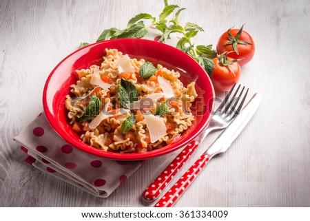 mafalda pasta with tomatoes mint and parmesan cheese flakes - stock photo