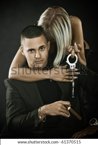 Mafia boss and woman in lingerie - stock photo