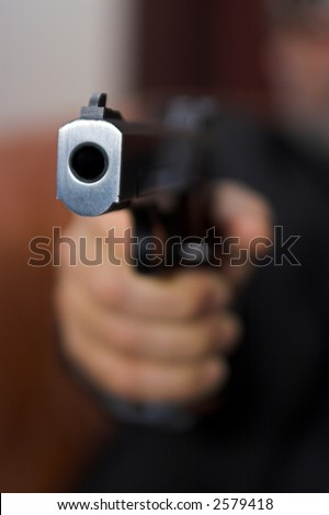 Mafia boss with a gun. - stock photo