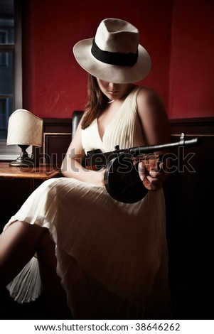 Mafia bride with hat holding a machine-gun - stock photo