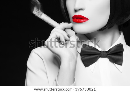 Mafia woman with cigar, red lips, selective coloring - stock photo