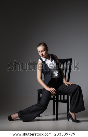 Mafiosi woman over dark grey background. Fashion photo. Retro style - stock photo