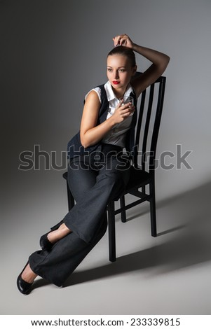 Mafiosi woman with  brandy glass. Fashion photo. Retro style - stock photo