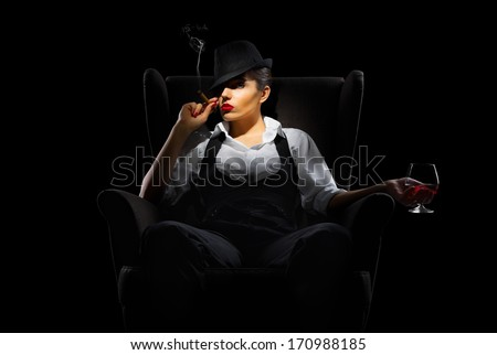 Mafiosi woman with cigar and brandy glass isolated - stock photo