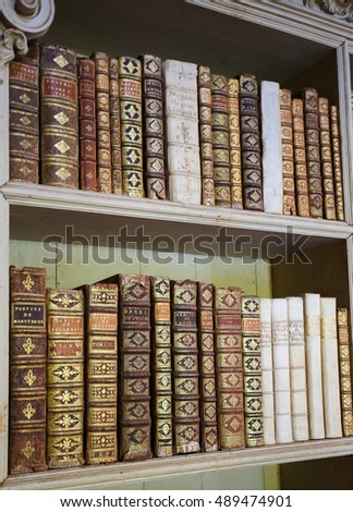 MAFRA, PORTUGAL - JULY 17, 2016: Old books in the library of Mafra Palace, Portugal