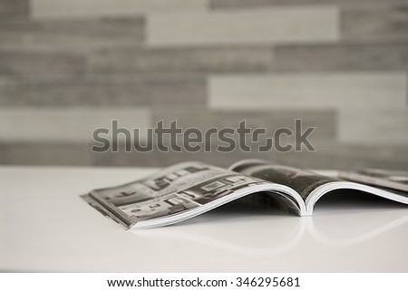 Magazine on the table in living room - stock photo