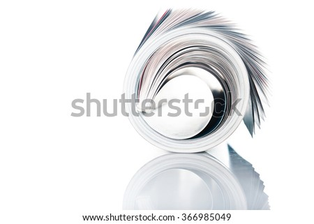 magazine roll on white background - stock photo