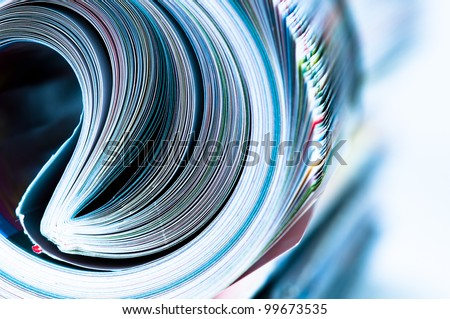 Magazine Roll. Side view. Blue toned - stock photo