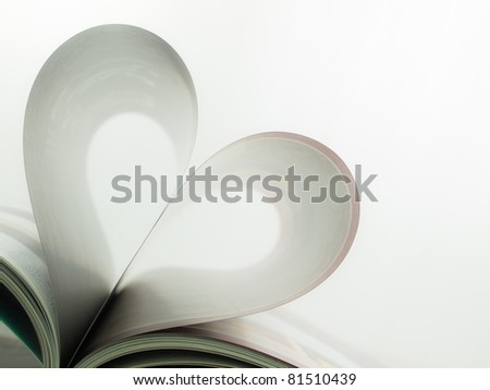 Magazine's page folded as a heart - stock photo