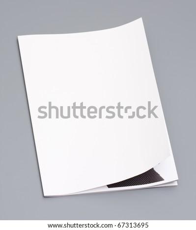 Magazine's page on gray background - stock photo