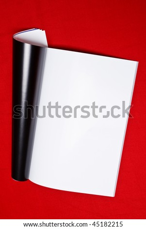 magazine's page on red background - stock photo