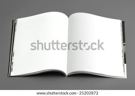 magazine's pages (broadside) on gray background - stock photo