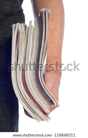 Magazines in hand isolated on white. - stock photo