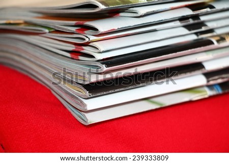 Magazines on the red sofa  - stock photo