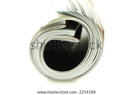 Magazines rolled up on an isolated background - stock photo