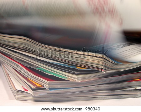 Magazines with a riffling blur aspect - stock photo