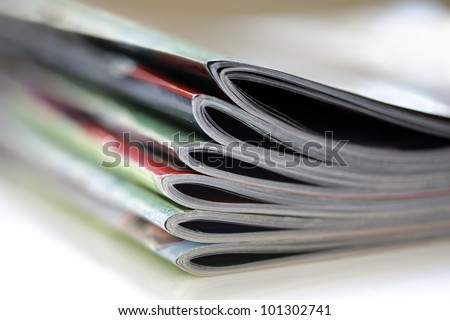 Magazines with selective focus on foreground edge - stock photo