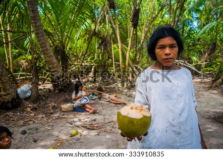 MAGDALENA, COLOMBIA - FEBRUARY 20, 2015: Young man from the Kogi people, indigenous ethnic group, living in Sierra Nevada mountain range in Santa Marta, Colombia - stock photo