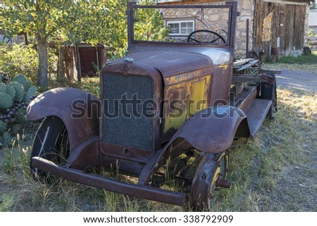 MAGDALENA - SEPTEMBER 21: residents placed old cars and trucks in the yards and in front of houses to attract tourists, September 21, 2015 at Magdalena, NM. - stock photo