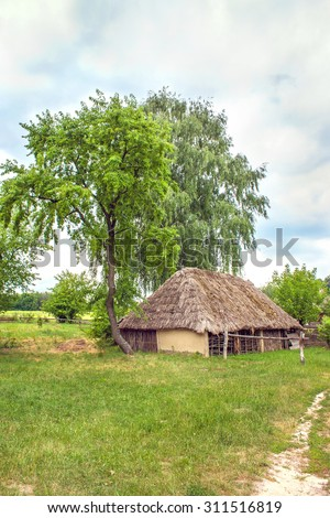 mage Ukrainian wooden barn Thatched locked uph - stock photo