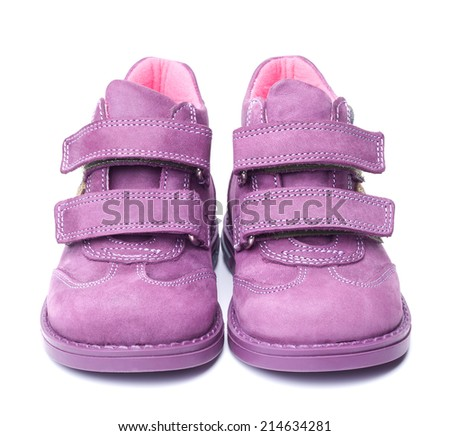 magenta children`s boots isolated on white background