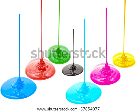 Magenta, cyan, yellow, red, blue, green and black liquid paints isolated - stock photo