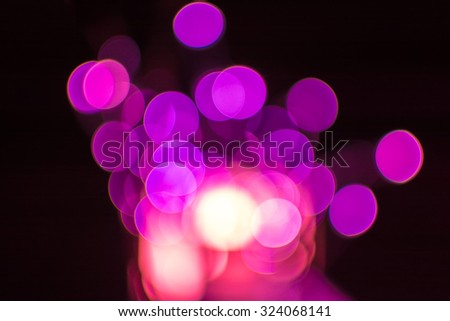 Magenta defocused bokeh Christmas lights on a wooden support - stock photo