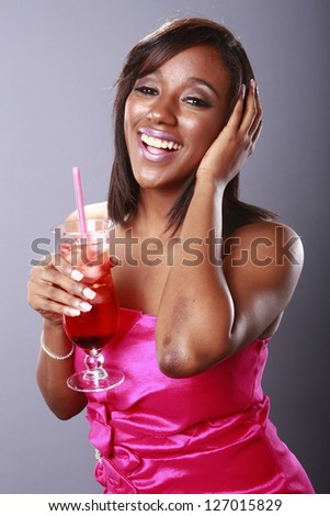 Magenta girl enjoys a red cocktail - stock photo