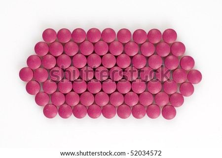 Magenta pills on a white background