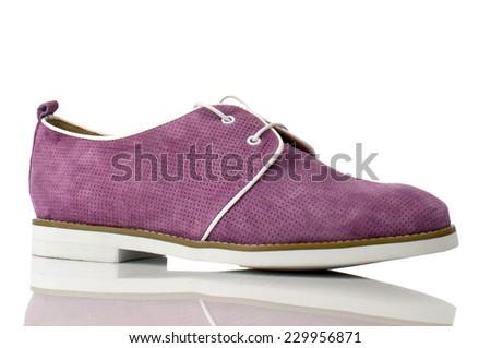 Magenta suede shoe with shoelace isolated on white background. - stock photo
