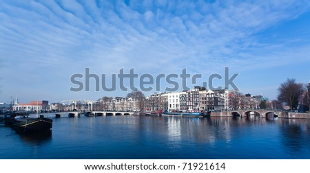Magere Brug bridge on the Amstel River in Amsterdam on a cold winters day - stock photo