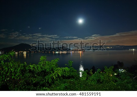 Maggiore Lake under the moon light, Arona, Italy