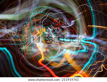 Magic abstract background, vortex of light trails of evening Moscow city - stock photo