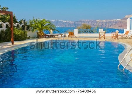 Magic blue swimming pool on island of Santorini, Fira in Greece. Caldera view on a background. - stock photo