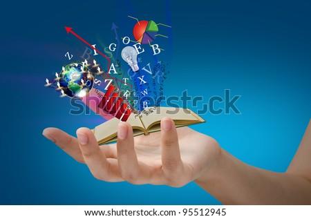 Magic book on hand - stock photo
