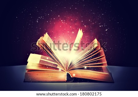 magic book open and the light from it - stock photo