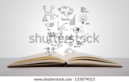 Magic book with business concept and graph - stock photo