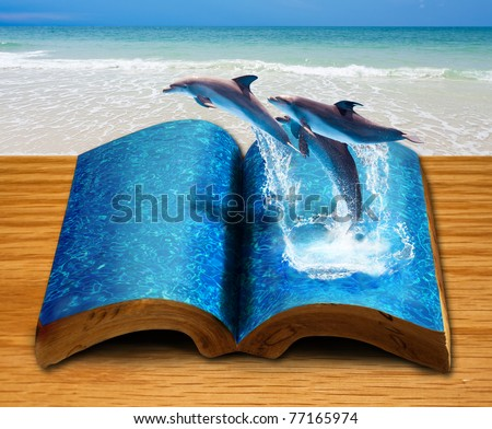 Magic book with three dolphins jump from book page - stock photo