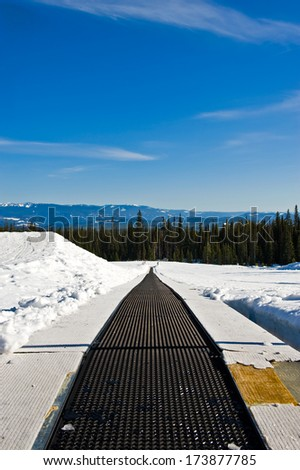 Magic carpet on a ski hill. - stock photo