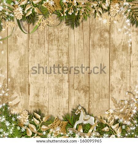 Magic Christmas garland on a wooden background - stock photo