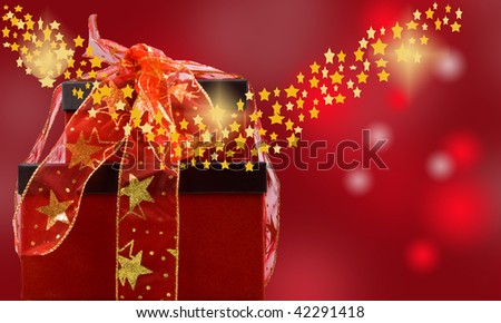 magic christmas of presents and glowing stars with diffused background - stock photo