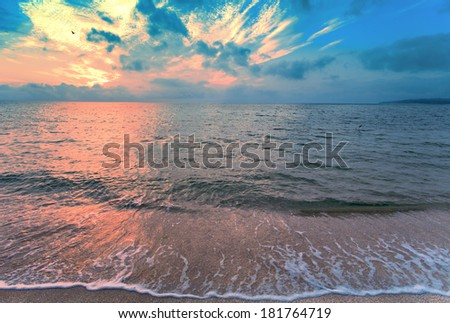 Magic colorful sunset over seashore