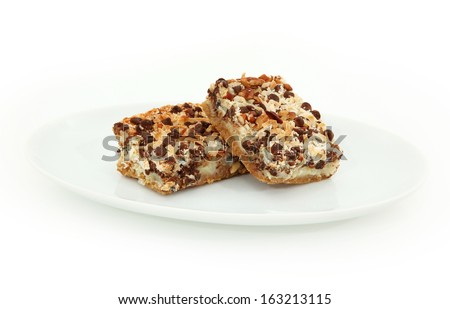 Magic Cookie Bars On Plate Isolated On White Background - stock photo
