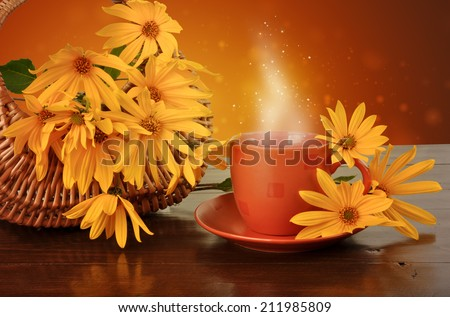 Magic drink and a basket of flowers on a wooden table