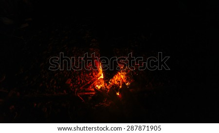 Magic fire on the river bank . Sparks, flames and other wonderful backgrounds for your text.