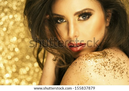 Magic Girl Portrait in Gold. Golden Makeup  - stock photo